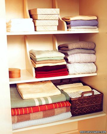 Shelf brackets as clothing divider, via Martha Stewart